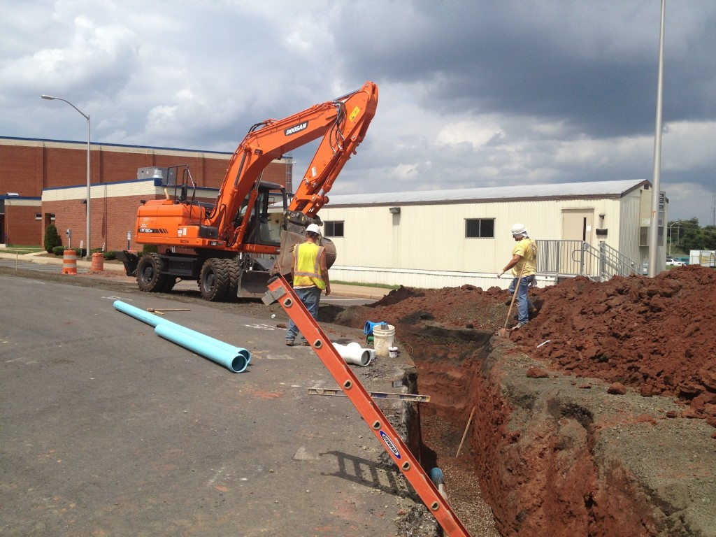 FINLEY UTILITY CREW INSTALLING A NEW SANITARY LINE AT OSBOURN PARK HIGH SCHOOL LOCATED IN MANASSAS, VA.