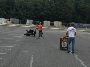FINLEY CREWS CLEANING AND CRACK FILLING THE STUDENT PARKING LOT AT POTOMAC SENIOR HIGH SCHOOL LOCATED IN WOODBRIDGE, VA.