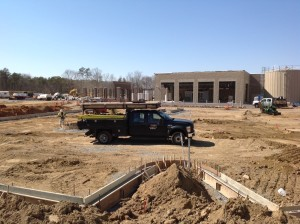 CONCRETE CREW PERFORMING CURB & CUTTER BEFORE PAVING AT WAL-MART IN ORANGE VA.